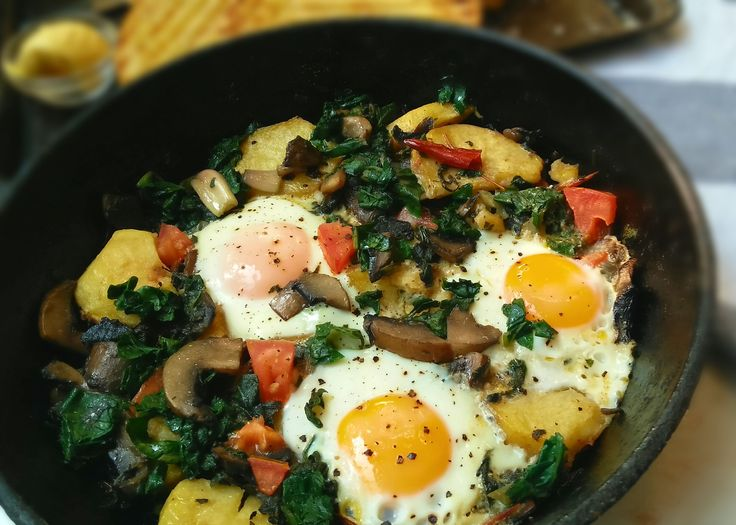 A hearty Country Style Breakfast, perfect for a weekend on the patio.A delicious combination of vegetables topped with sunny side up eggs and parmesan.
