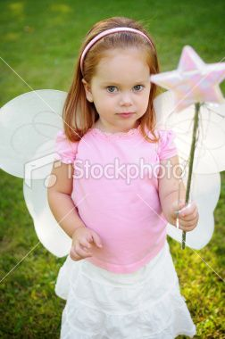 Little Girl with Fairy Wings and Magic Wand Royalty Free Stock Photo