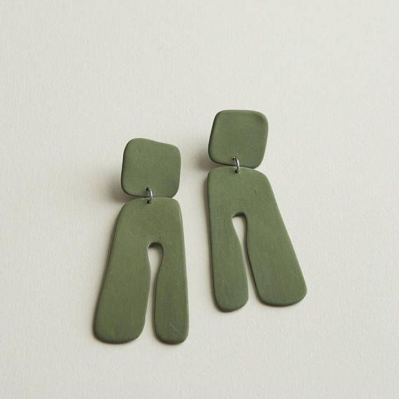 Colored porcelain earrings •thin and lightweight •sterling silver post •unglazed, except black, it has a clear shiny glaze •each piece is hand cut and may vary a bit •3 3/8 L x 1 3/8 W Care Porcelain jewelry is fragile, but if cared for, can have a nice long life. Store them