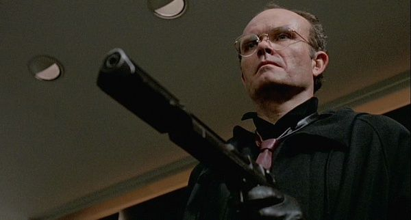 RoboCop (1987) - Clarence Boddicker (Kurtwood Smith) uses two different types of the Desert Eagle in the film. His main weapon is an Desert Eagle Mark I in .357 Magnum with an elongated threaded barrel (sometimes fitted with a suppressor). He also uses one without the extended barrel during the drug lab shootout.