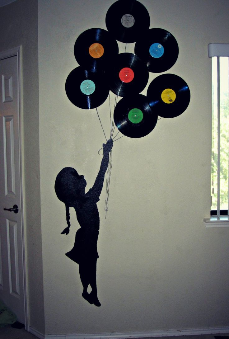 Decoracion en pared con discos                              …