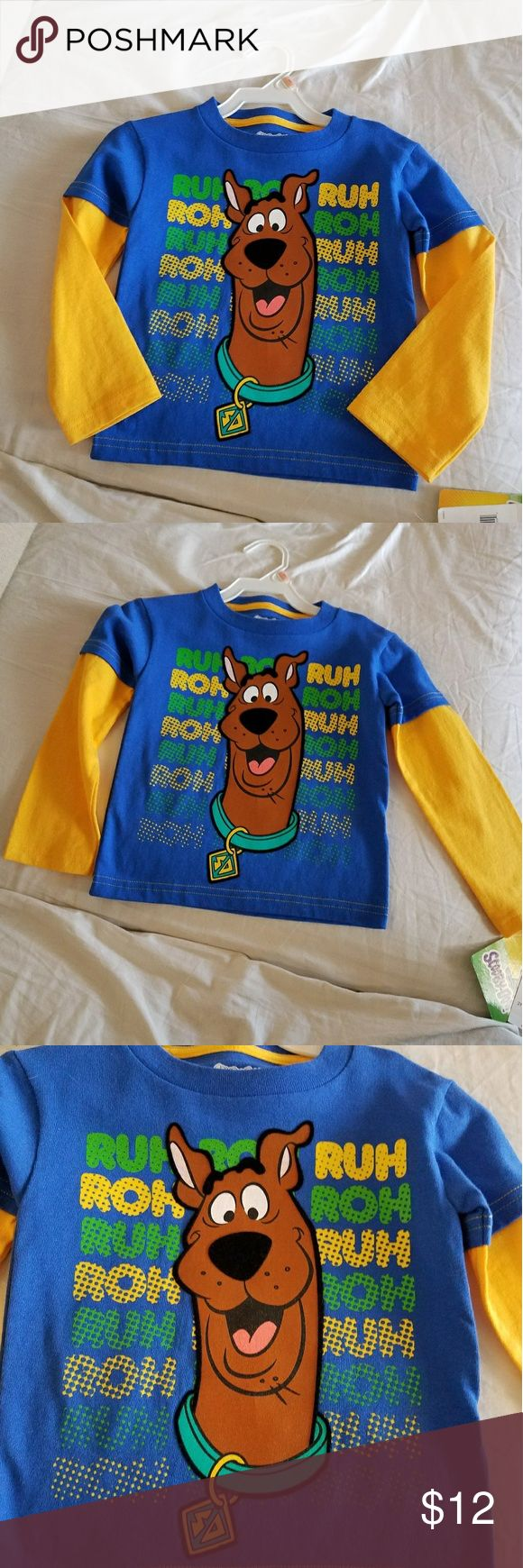 New Scooby Doo RUH ROH Long Sleeve T-shirt New Scooby Doo RUH ROH Long Sleeve T-shirt New with tags  Size 2y Blue with Yellow  Material 100%Cotton   I do bundle and offers are welcome Scooby doo Shirts & Tops Tees - Long Sleeve