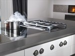 Gas hob pulls steam away from food, chef and furnishings. Hat tip Archiproducts.com.  Gas hob designed by Willi Bruckbauer.