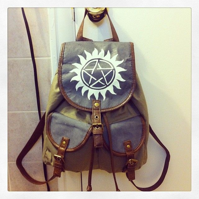 I made this for myself. It's a Hunter's Backpack!! The grey used to be a floral pattern, but I am not a girly flowery person so I painted it grey and added the anti-possession symbol. Plus with the...