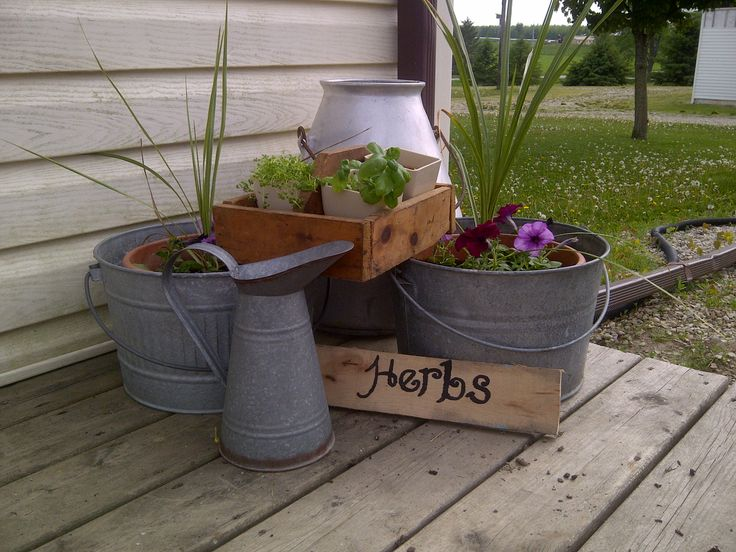 Galvinized steel buckets, milk can, and pitcher flower planters and wooden herb box