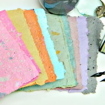 Make handmade paper using old newspapers and acrylic paint for color. Watch the video tutorial here: https://www.youtube.com/watch?v=mNSkQEMxoIk