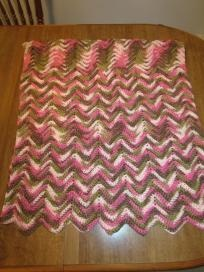 """Variegated green, brown, light and dark pinks.  """"Ripple"""" stitch afghan. 100% Acrylic yarn.  Large """"Lap"""" afghan or small cover-up.  58"""" long x 27 1/2"""" wide.  Machine wash in warm/cold water. Dry on low heat. May lay flat to dry. Do not hang to dry-..."""