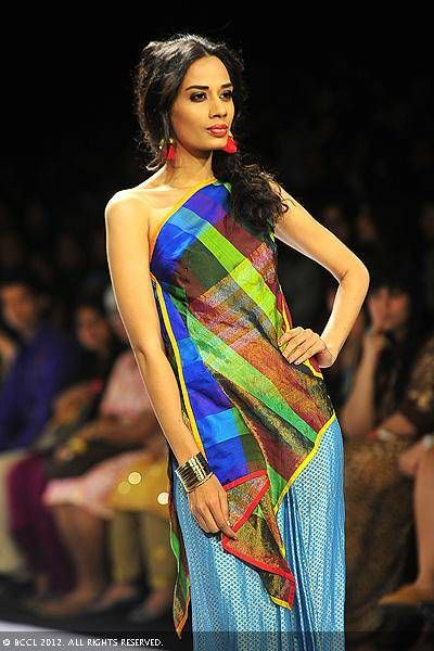 A model walks the ramp for designers Mayank Anand and Shraddha Nigam on Day 3 of the Lakme Fashion Week (LFW) 2012 at Grand Hyatt in Mumbai.