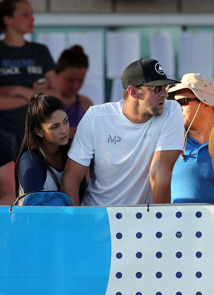 Michael Phelps Photos Photos - Michael Phelps and his wife Nicole watch a race on day two of the Arena Pro Swim Series - Mesa at Skyline Aquatic Center on April 14, 2017 in Mesa, Arizona.  (Photo by Chris Coduto/Getty Images) * Local Caption * Michael Phelps;Nicole Phelps - Arena Pro Swim Series Mesa - Day 2