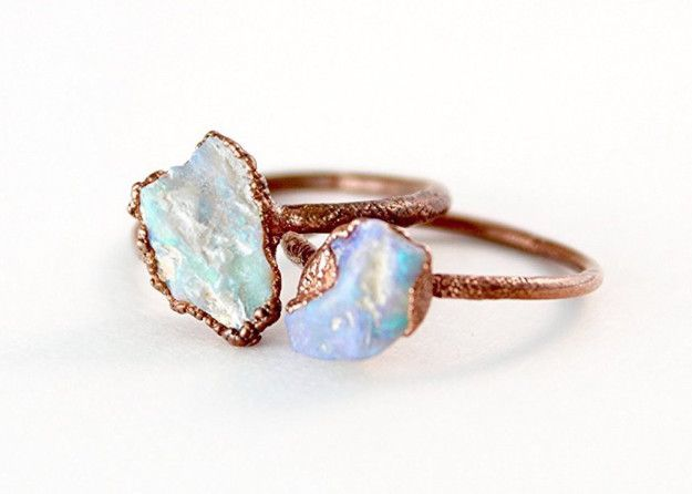 An iridescent raw opal ring that's a little rough around the edges. | 31 Stunning Engagement Rings That Aren't Made With Diamonds
