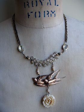 "Two Birds, One Rose, Vintage Repurposed Necklace Oh mama. This necklace is amazing. Truly. The two swallows is a heavy sterling silver repurposed brooch. It has a sort of gold wash on it so it reads as gold but is stamped ""sterling"" on the back. They are detailed and just lovely. I wire-wrapped, with gold-filled wire, a vintage repurposed..."