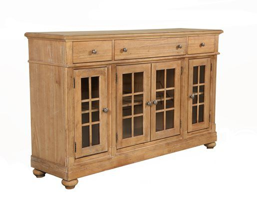 The sand buffet feature full extension metal side drawer glides and an english dovetailed front and french dovetailed back drawer construction. Four glass doors and three storage drawers, one of which is felt lined for silver.