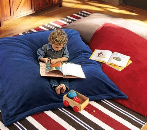 Supersoft, extra-big pillow is the ultimate spot for reading, watching TV and enjoying quiet time. In cozy faux chamois or our new plush faux sherpa, it can be used as a floor pillow or as a chair, and is filled with eco-friendly recycled beads.