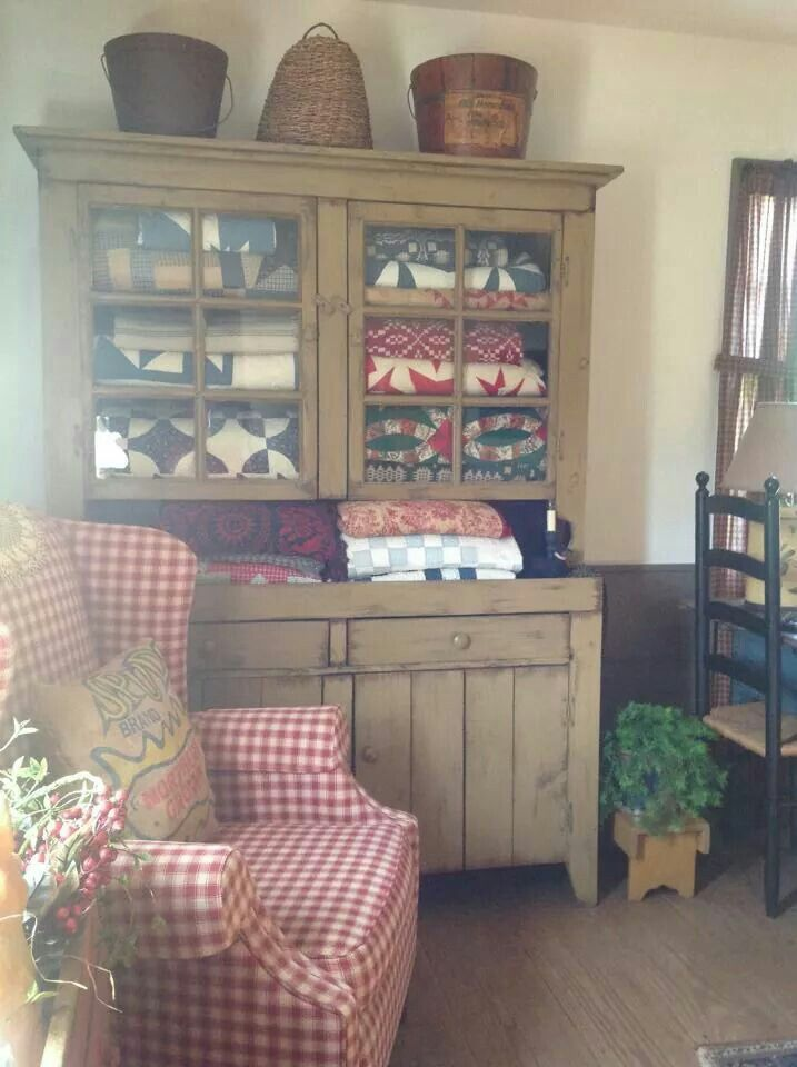 love the gingham chair and hutch with quilts