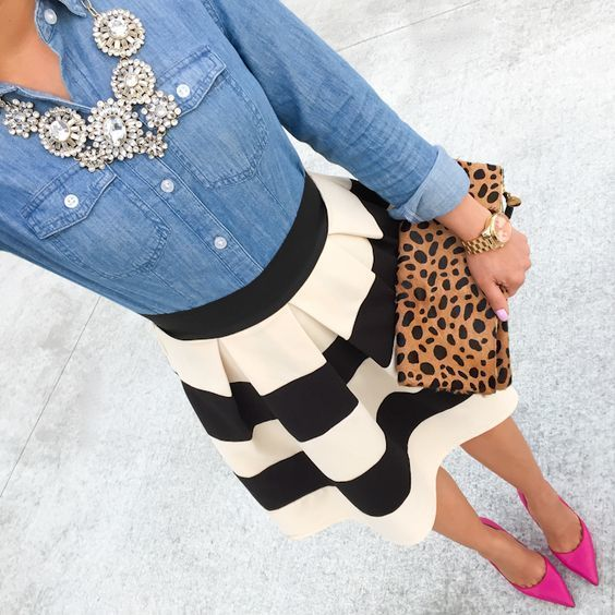 A blue denim shirt and a black and white striped skater skirt will showcase your sartorial self. Throw in a pair of hot pink suede pumps to instantly up the chic factor of any outfit. Shop this look on Lookastic: https://lookastic.com/women/looks/denim-shirt-skater-skirt-pumps/17153 — Silver Necklace — Blue Denim Shirt — Black and White Horizontal Striped Skater Skirt — Tan Leopard Suede Clutch — Hot Pink Suede Pumps