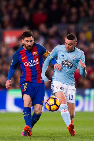 Lionel Messi (L) of FC Barcelona competes for the ball with Iago Aspas (R) of RC Celta de Vigo during the La Liga match between FC Barcelona and RC Celta de Vigo at Camp Nou stadium on March 4, 2017 in Barcelona, Catalonia.