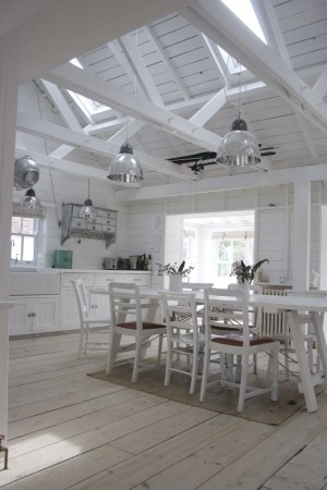 Nordic style, white kitchen, beam and vaulted ceiling and skylights.