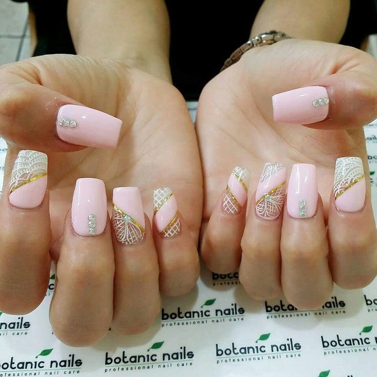 Pink and white and golden nails. Nail art, lace, stone, beautiful