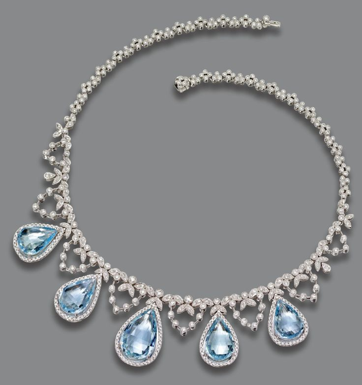 AQUAMARINE AND DIAMOND NECKLACE.  The necklace of delicate garland design set with numerous small round diamonds, supporting 5 pear-shaped aquamarines weighing approximately 35.50 carats, within borders of small round diamonds, the total diamond weight approximately 7.25 carat, mounted in 18 karat white gold, length 15½ inches.
