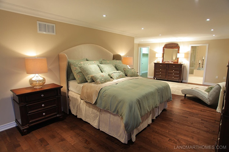 The wood tones and light colour pallet warm up this cozy bedroom. Meadowlands in Ancaster, Ontario. By Landmart Homes. #hamont #bedroomideas