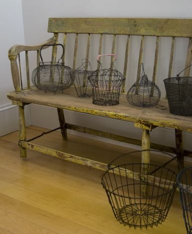 the old egg baskets are cute, and the bench is great, I can imagine it with some ticking cushions