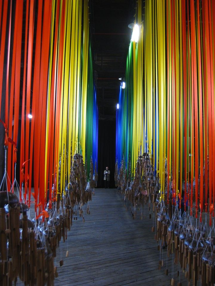 gorgeous installation consisting of hundreds of bamboo wind chimes hanging from rows of colored ribbons. Called Knock On The Sky Listen To The Sound, it's by artist Tiffany Singh
