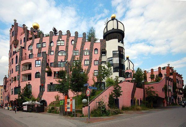"""Grüne Zitadelle"" - Green Citadel  Magdeburg. Germany. built in 2005 in the style of Hundertwasser by Peter Pelikan (design) & Heinz M. Springmann. Astrogeographic position: air sign Libra sign of harmony, balance, beauty, decoration, naive painting, openness, stages with creative, innovative, spiritual air sign Aquarius sign of the sky, heaven, paradise, self-finding, liberation, holistic & alternative technologies. FL 3."
