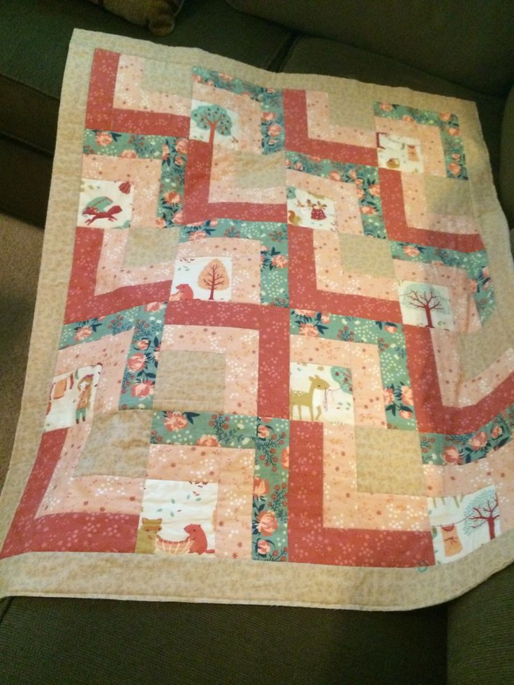The first baby quilt. Fussy cuts of the woodland scenes made this super cute.