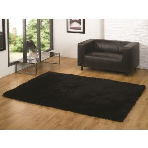 Black Shaggy Rug 100% polyester with a mixture of textures to give a soft grass like feel underfoot http://www.therughouse.co.uk/rugs/luxury-black-shimmer-quality-shag-rug-memphis.html