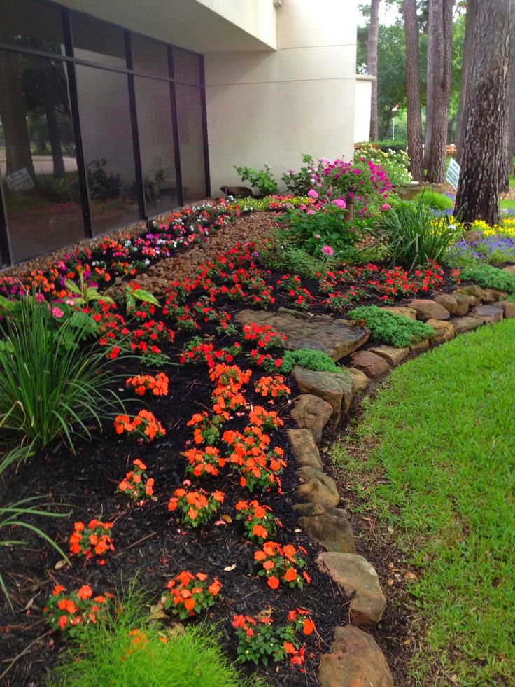 Multicolored Flowers And Moss Rock And Boulder Flowerbed
