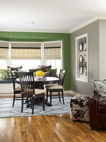 The green accent wall would be ideal to place stainless washer and dryer if combined with the gray walls