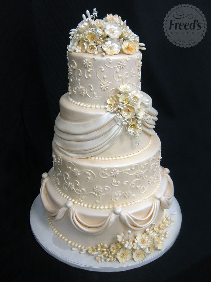 """Peach Chiffon wedding Cake""   ~ sugar flowers, scroll work, Pearls and draping ~ all edible"