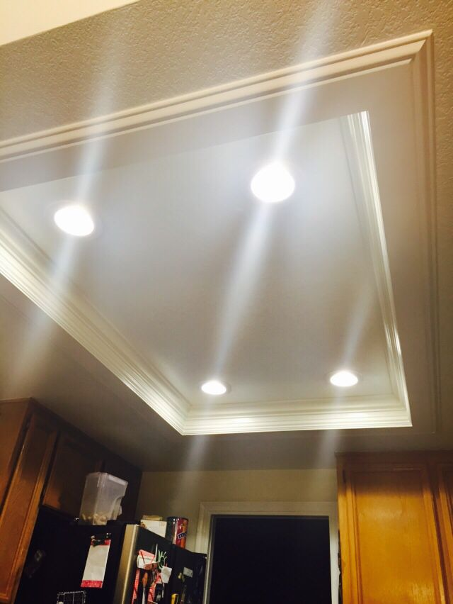 Flourescent lights removed and replaced with recessed light and trim. ~ exactly what I want to do in my craft room closet!
