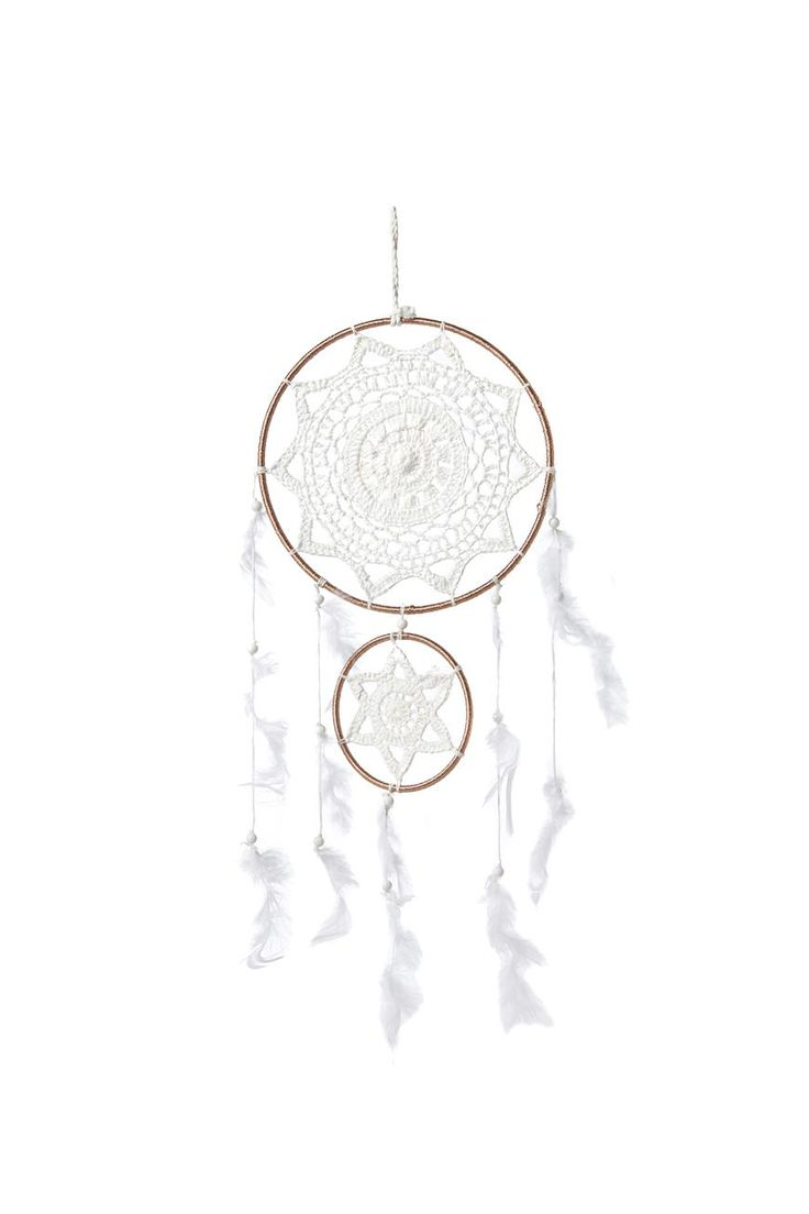 This double dream catcher is the next big thing in dream catchers. <br> Hand made in India, each hoop has a crochet centre and metallic rose gold and white hanging trims. <br> Dimensions: 20cm wide and approx 45cm long. <br/>