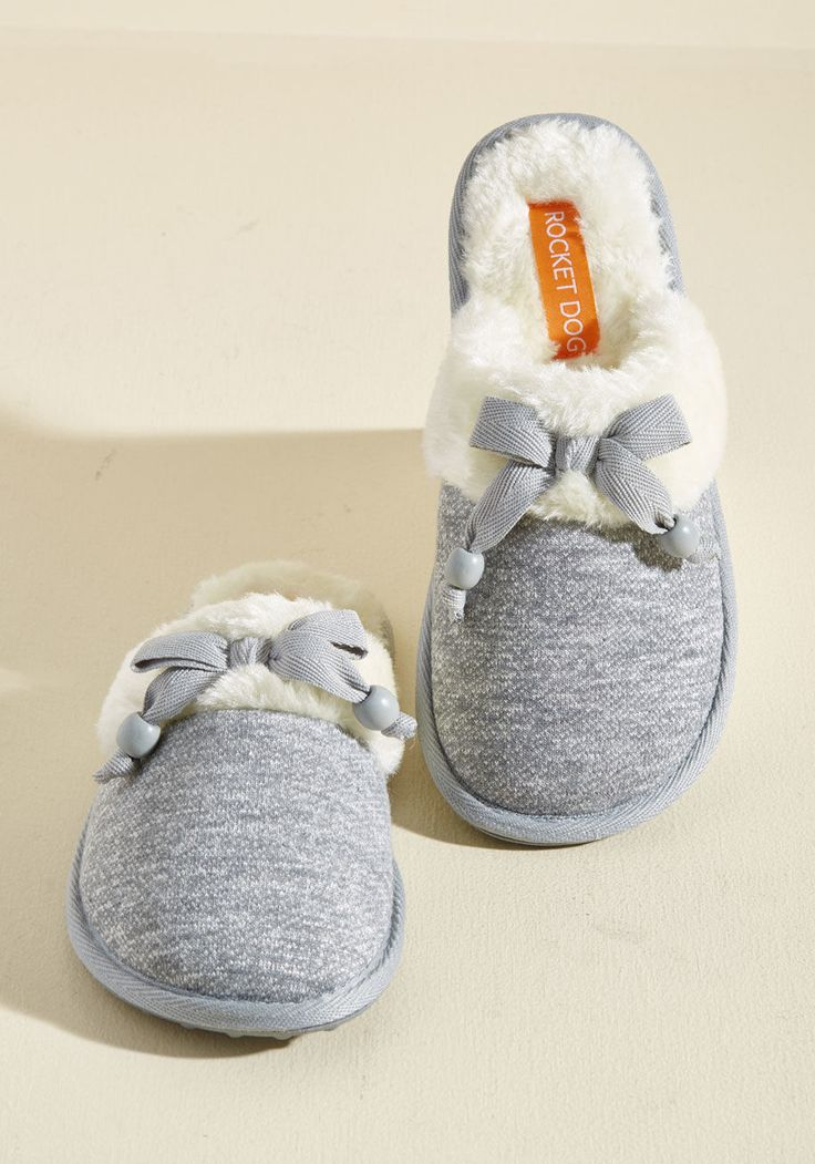<p>What an ideal day - your chocolate bevvie is boiling and these grey slippers from Rocket Dog are keeping your toes toasty! From your shuffle in the kitchen to your cuddle on the couch, the beaded bows and faux-fur linings of this knit pair makes your morning all the more marvelous.</p>