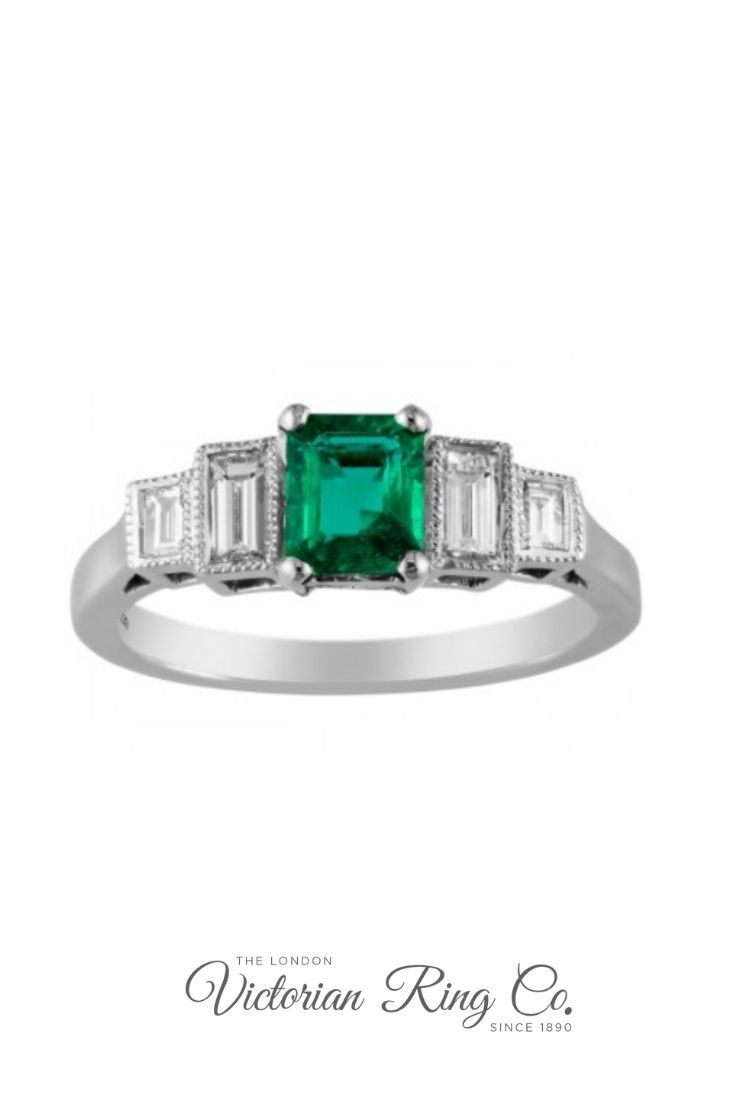 f36e5666d467a2 This show-stopping emerald and diamond ring in platinum is set with a  sparkling emerald-cut shape central gemstone. On either side of the green  gemstone are ...