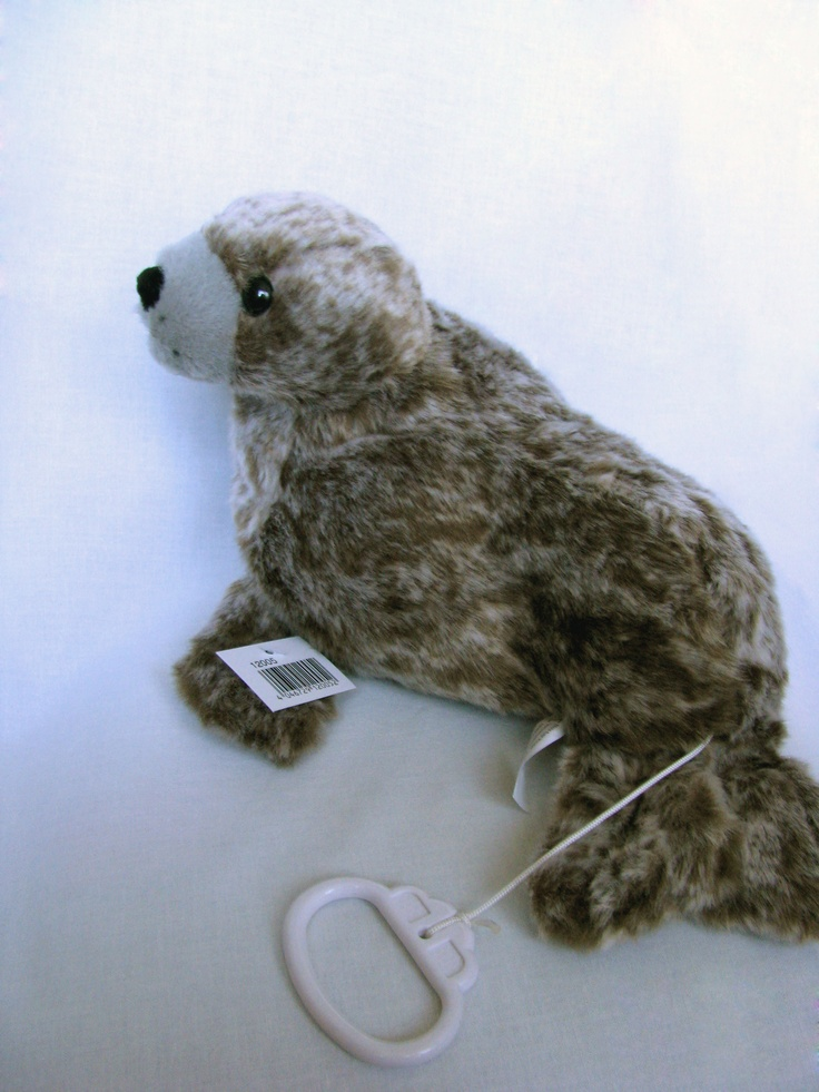 """Seal plush music box. Melody: lullaby.     Music box seal seal plush, stuffed animal NEW.     length 24cm.     After the pull on the cord can hear the tune """"Brahms Lullaby"""".     Very soft and cuddly plush.     manufactured in Germany.http://www.sammler-und-hobbyshop.eu/Seal-Seal-plush-music-box-Melody-lullaby"""