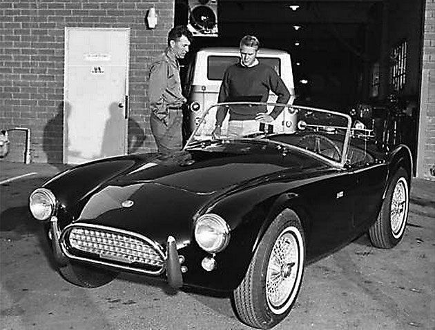 Actor Steve McQueen discusses the AC Cobra with Carroll Shelby at the Shelby American plant in Venice, California.
