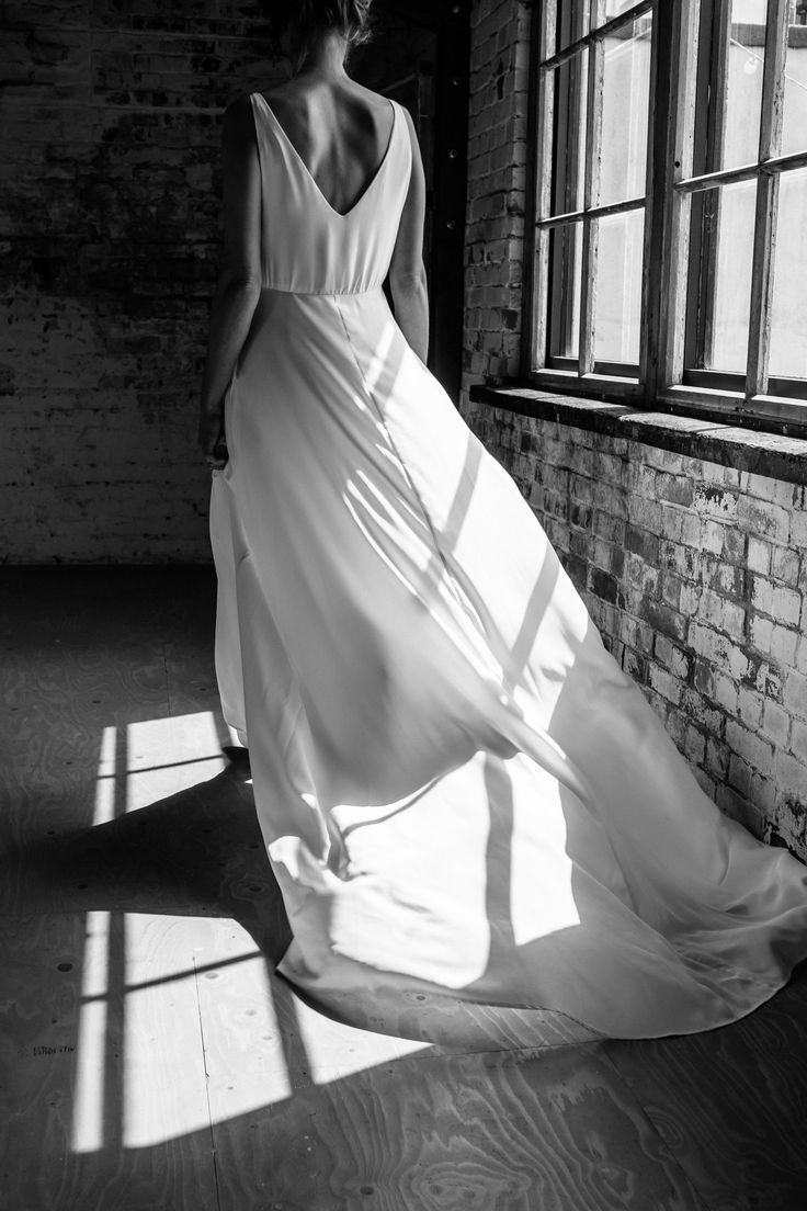 B R I G I T T E - True modern elegance. The Brigitte dress is a simple V neck, sleeveless dress with an A-line skirt and flowing train. Finished with a gorgeous, tonal beaded embellishment for the perfect detailing on these clean, classic lines.⠀ ⠀ ______________________ ⠀ Image by @joannabrownphotos ⠀ Hair & Make up by @beautifullyhitched ⠀ Modelled by @charverity ⠀