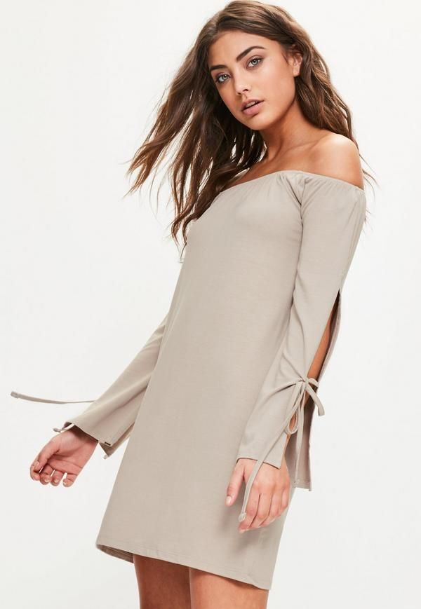 opt for a bardot style to elevate your day game. We're lusting over this grey shift dress with brown undertones - featuring tie sleeves, a mini length and elasticated bardot top.