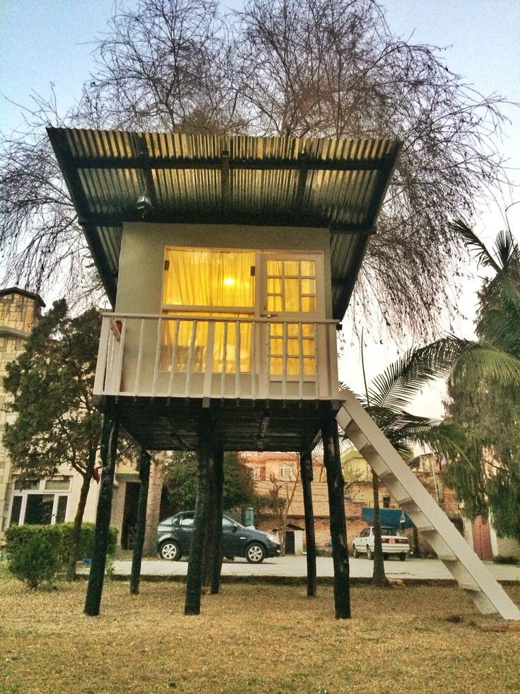 Treehouse / Stilt house. 8ft x 8ft. Corrugated steel roof, plywood interior, real wood floor, real wood balcony, water-proofing paint, steel sheet cladded joints, modernist cube design, steel sheet side cladding, raised on wooden poles 6ft high. Construction time 2 weeks. Based in Kathmandu, Nepal.