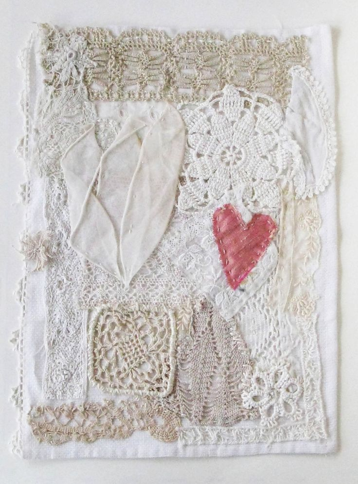 Made from pieces of vintage lace and hand-stitched on a vintage cloth, with a little pink silk heart. ~ by Colette Copeland