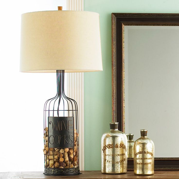 Ahhhh!  I need this!  A wine cork lamp!!!!  Wine Cork Display- I'm thinking like small bird cage, not a lamp.