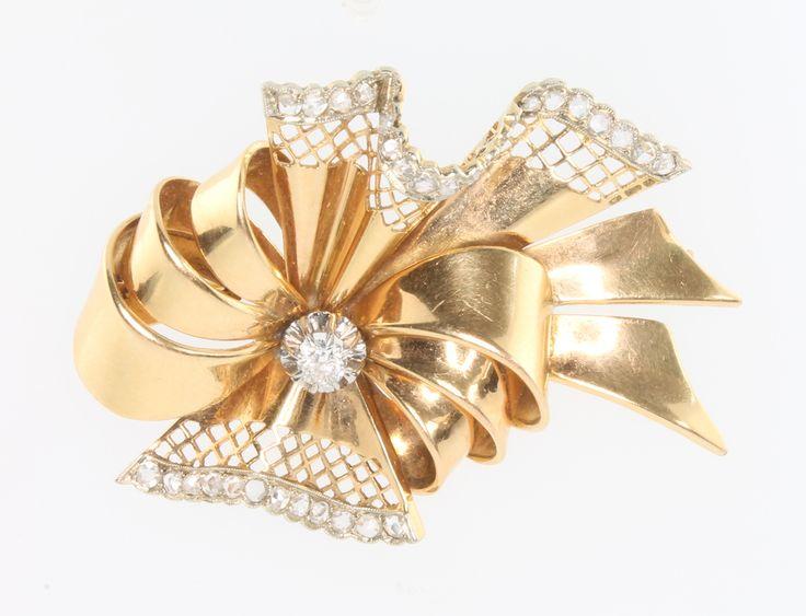 Lot 650c, A 1970s 18ct yellow gold 33 stone  diamond set ribbon brooch 18.6 gr, est £800-900