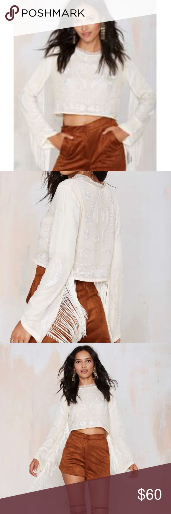Bohemian Bones Witchy Woman Embroidered Crop Top The Witchy Woman Top is beige and features cream embroidery, mesh overlay, fringe detail, and cropped length. Fully lined. . By Bohemian Bones.  *Viscose *Runs true to size *Dry clean *Imported  no trades/modeling Nasty Gal Tops Crop Tops