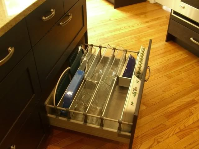 I love this idea. I dislike having to lift a stack of heavy glass bakeware to get the pan I need.
