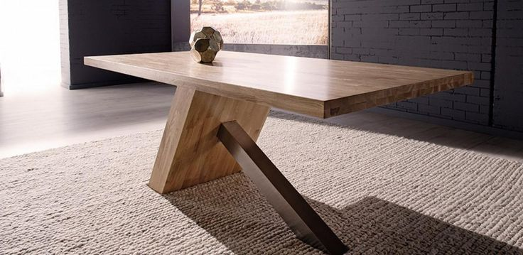 A solid oak top with finger joint pattern and a brushed stainless steel leg. The NOLAN is a stylish new design that is sure to intrigue and create conversation with visitors and family. The NOLAN series is also available in a coffee table and buffet to co