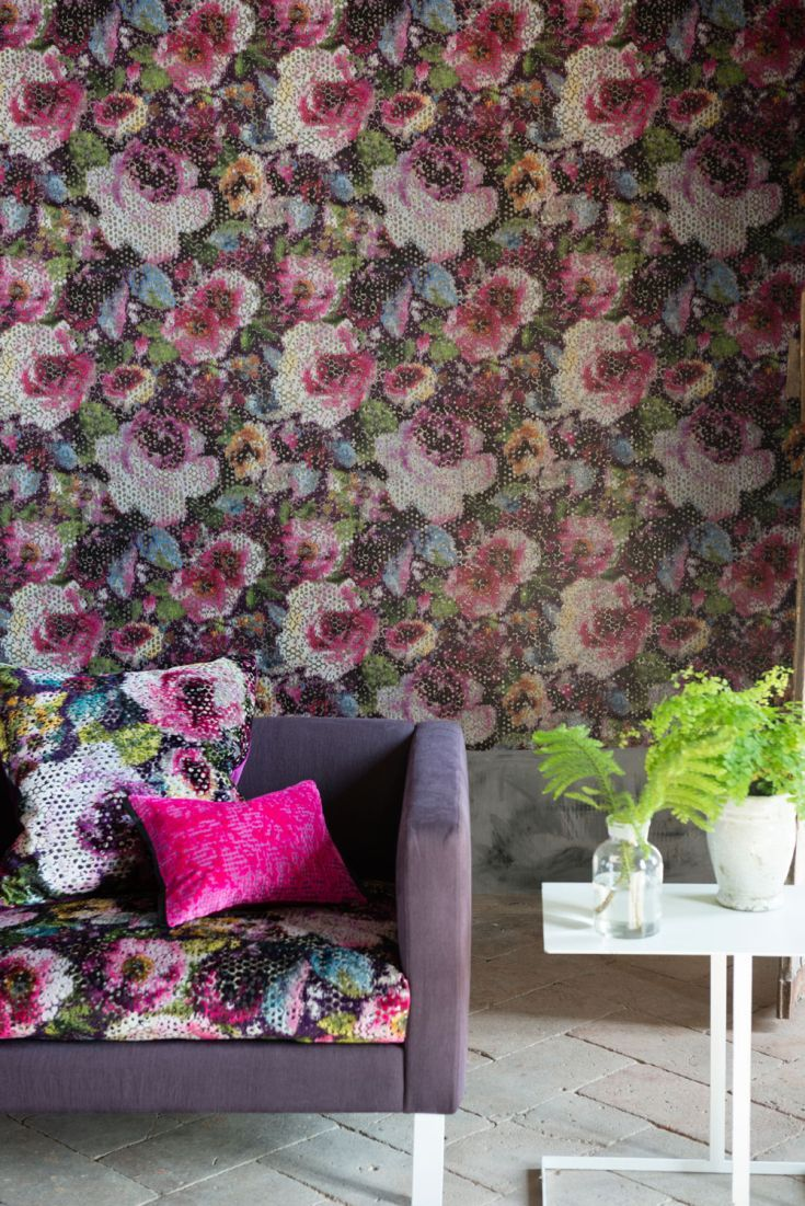 Predominantly pink multicoloured wallpaper design with shimmering silver highlights. A heavyweight non-woven paper for easy hanging and wash ability. Wide width for better wall coverage and more liberated design.