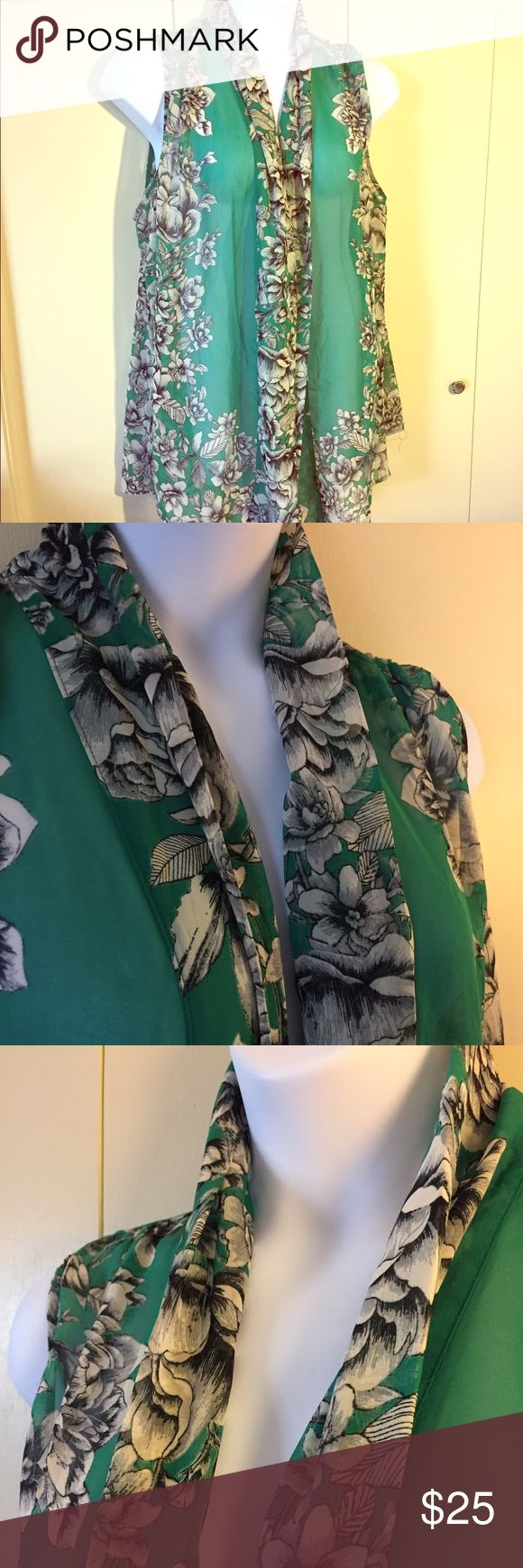 Susan Graver sheer open front tunic. Beautiful flowers on a sea of green make this Susan Graver tunic a must have for Spring and Summer. It's in perfect condition, 100% polyester and is a 2X. Susan Graver Tops Tunics