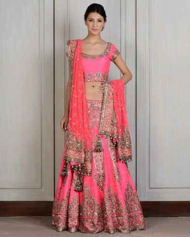 Pink color lehenga choli: The lehenga part of this pink lehenga choli is of raw silk intricately hand-embroidered with regal motifs all around.